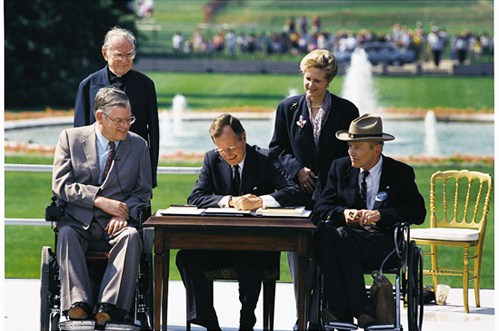 Bush signing ADA in 1990