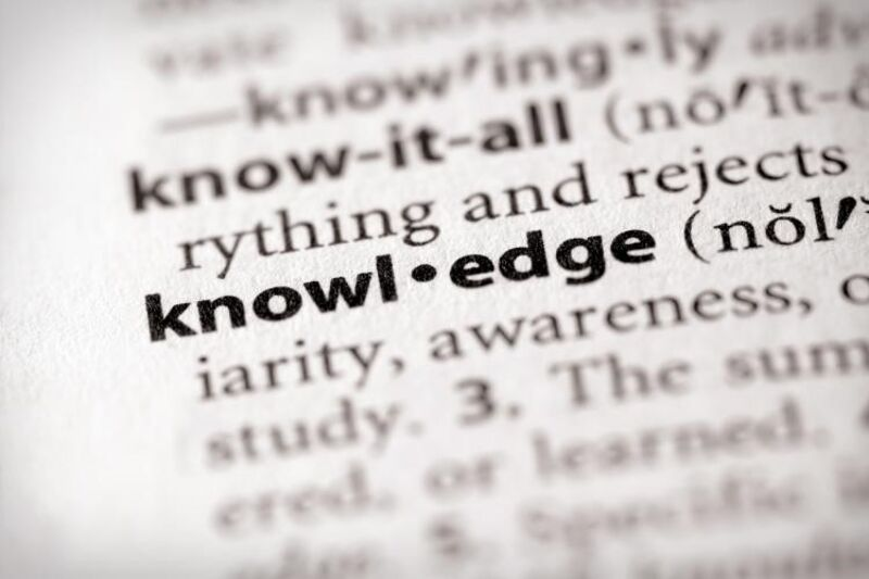 : A zoomed in photo of a dictionary page, highlighting the word knowledge.