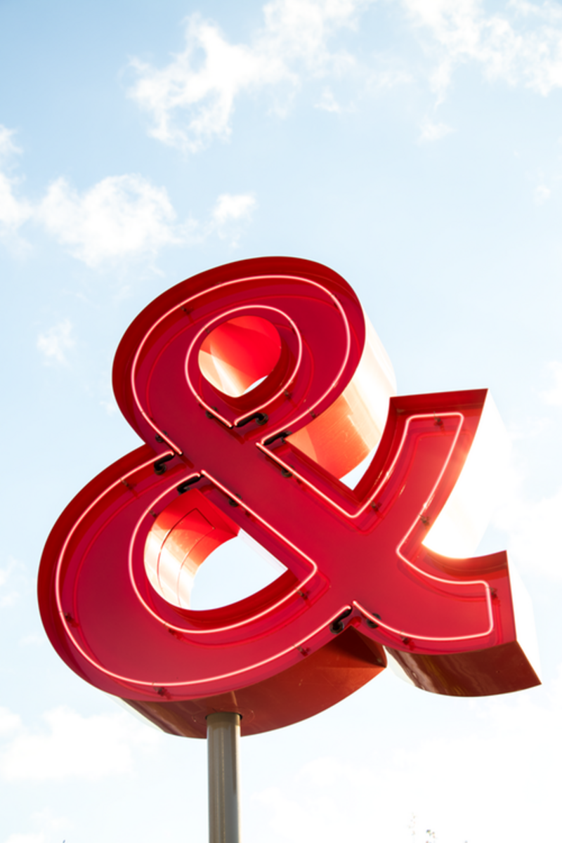 A large red ampersand sign
