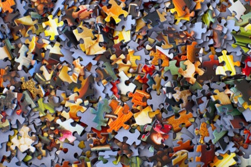 A pile of jigsaw puzzle pieces