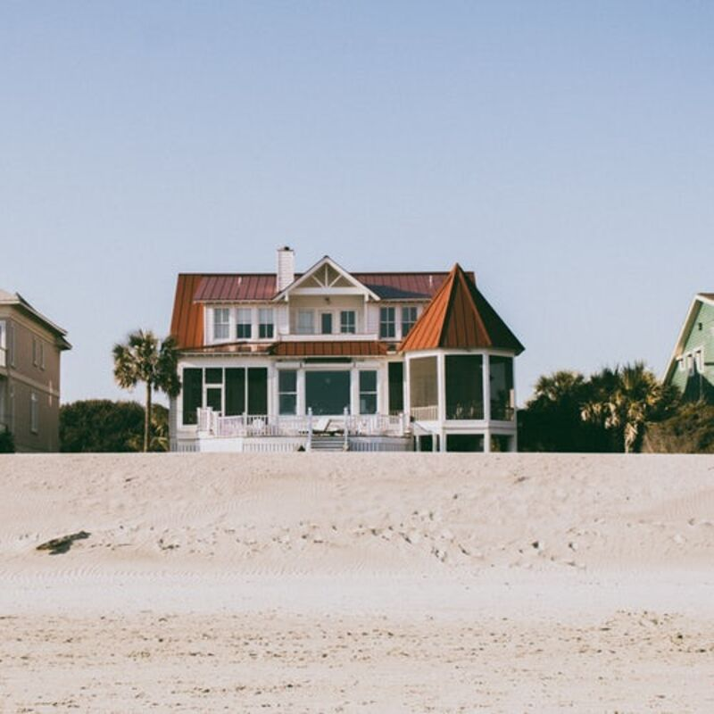 White and brown two-story house on the beach