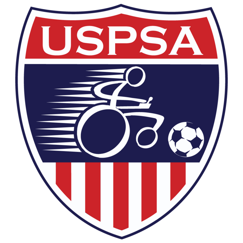 The official logo of the United States Power Soccer Association. A red, white, and blue shield with a wheelchair icon pushing a soccer ball.