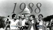 People standing in front of capitol building with with the year 1988 in the background