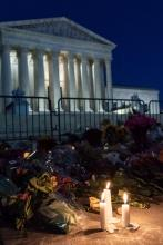 A candle lit before the White House in honor of the late Supreme Court Justice, Ruth Bader Ginsburg.